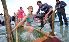 Фоторепортаж: как православные всего мира отметили Крещение