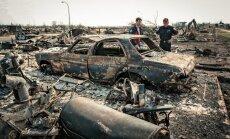 Postošie ugunsgrēki Kanādā turpinās: simtiem naftas ieguves darbinieku spiesti bēgt