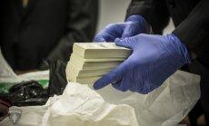 Vērienīgo naudas viltotāju lietu nodod prokuratūrai; neīstie dolāri izplatīti arī Anglijā un ASV