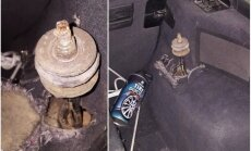 Foto: Tūlīt pēc 'ceļa nodokļa' samaksāšanas BMW bedrē izlauž amortizatoru