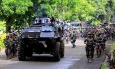 Foto: 'Daesh' kaujinieki Filipīnās terorizē pilsētu