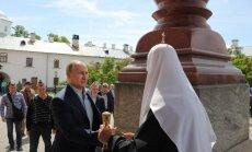 """Раскрыты тайна красной """"сумки"""" и имя спутницы Путина в монастыре"""