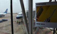 ASV dūmojoša 'Samsung' telefona dēļ evakuē pasažieru lidmašīnu