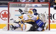 Marc-Andre Fleury and Toronto Maple Leafs forward James van Riemsdyk