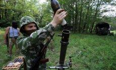 Foto: Separātistu bataljons 'Vostok' trenējas mežā pie Doņeckas