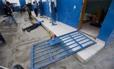Haiti no cietuma izbēguši 174 cietumnieki; nogalināts apsargs