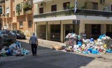 Karstums un atkritumu izvedēju streiks rada krīzi Atēnās