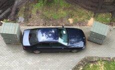 Foto: Kā celtnieki Pļavniekos izāzēja nekaunīgu BMW īpašnieku