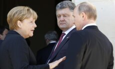 Putins tiksies ar Merkeli un Porošenko