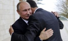 Foto: Putins Sočos silti uzņem al Asadu