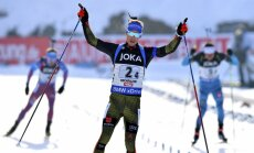 Germany Simon Schempp celebrates finishMixed relay