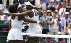 Serena Williams of the U.S.A. embraces Venus Williams