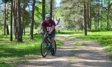 Foto: Daugavas lokos aizvadīts tūrisma triatlons