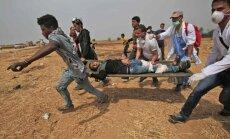 Foto: Pie Gazas joslas un Izraēlas robežas izceļas sadursmes; divi bojāgājušie