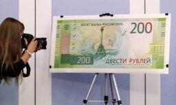 Latvijas finanšu iestādes pieņems Krievijas rubļa banknoti ar okupētās Krimas skatiem