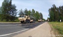 Video: Pa Tallinas šoseju transportē militāro tehniku