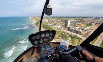 Video: Ar mazo 'Robinson R44' pāri nelielajai Izraēlai