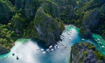 Tirkīzzilā paradīze: caurredzams un akmens veidojumu ieskauts ezers Filipīnās