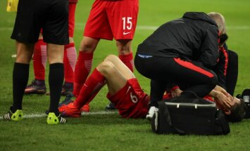 Poland Robert Lewandowski receives medical assistance after fire cracker