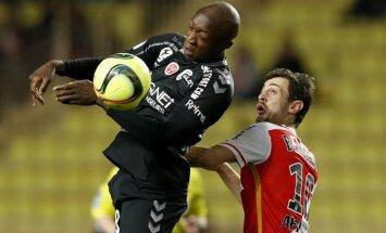 Monaco Silva Bernardo with Reims defender Antoine Conte