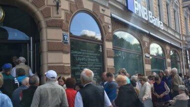 'de facto': 'Rīgas namu pārvaldniekam' 6 miljoni eiro iedzīvotāju naudas palikuši 'PNB bankā'