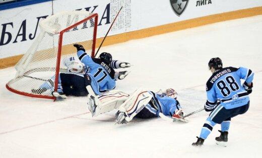 Sibir s Artyom Voroshilo goalie Alexander Salak and playr Konstantin Okulov
