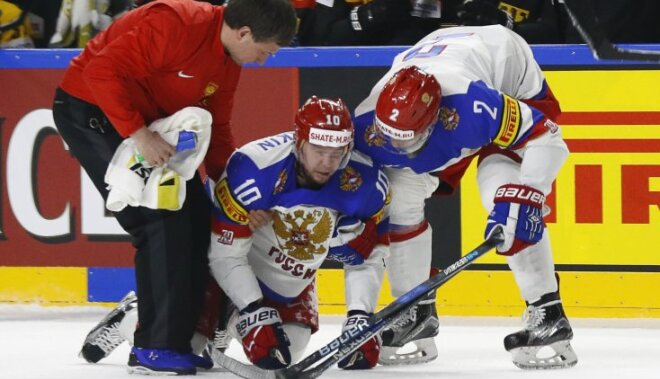 Sergei Mozyakin of Russia sustains an injury