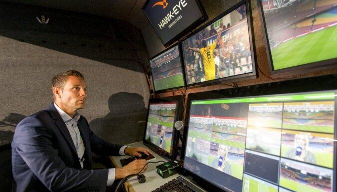 A referee looks broadcast Netherland Cup football match Ajax - Willem II