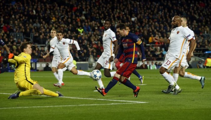 Barcelona s Lionel Messi scores the second goal against AS Roma