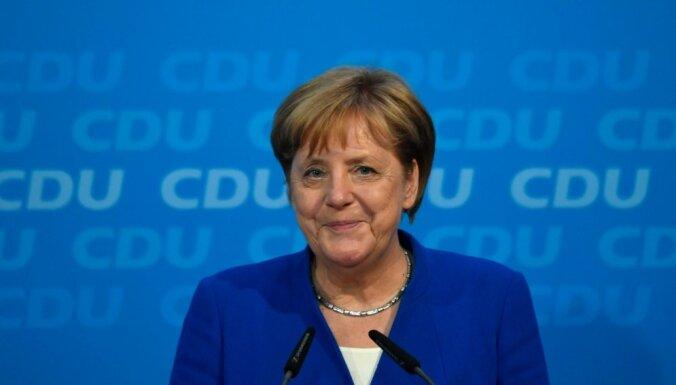 Merkele nākamā EK prezidenta izvēlē varētu piekrist kompromisam