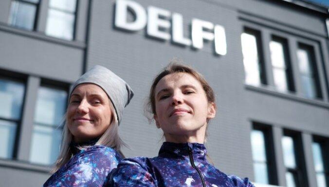 Foto: 'Delfi' atkārtoti uzvar 'Lattelecom' Rīgas maratona skriešanas dueļa atklāšanā