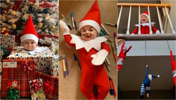 Piemīlīgi foto: mazulītis elfa kostīmā veic nedarbus svētku gaidās