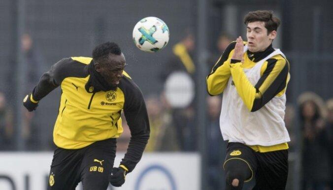 Bolts aizvadījis treniņu ar Dortmundes 'Borussia' futbolistiem: bija jautri