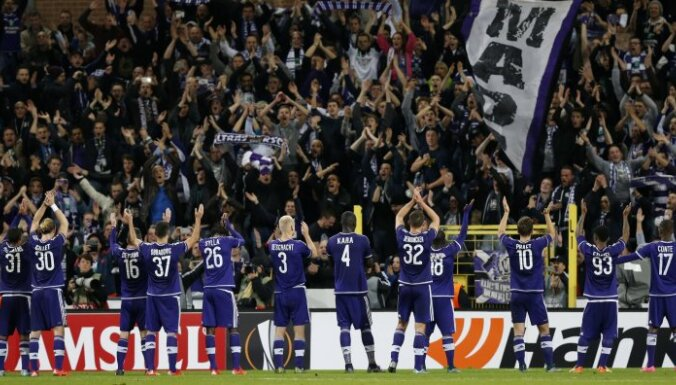 Anderlecht celebrate with fans after the game