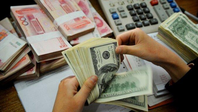 'Rīgas Namos' valūtas konvertēšanā 'izkūpējusī' nauda ir arestēta