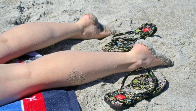 Legs on the beach realixing and catching the rays