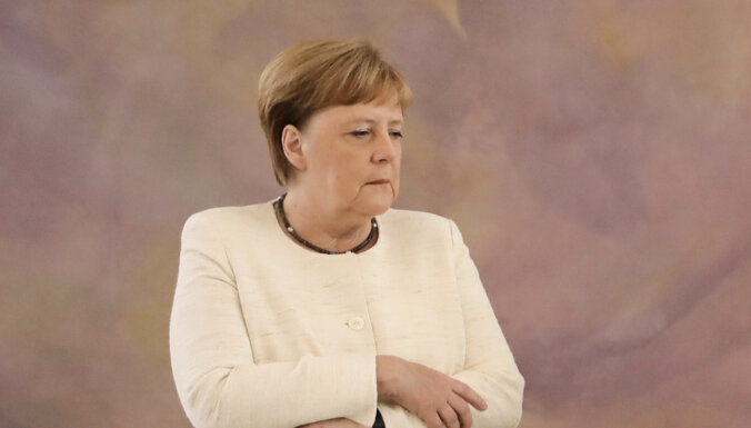 Merkeles partija cieš zaudējumus divu Vācijas zemju vēlēšanās, liecina sākotnējie rezultāti