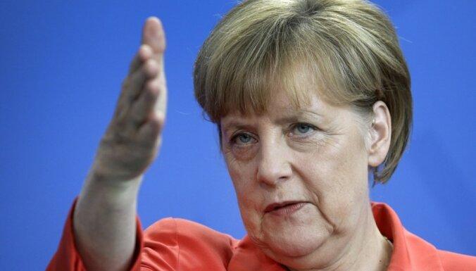 Меркель выступает за ускорение переговоров о зоне свободной торговли ЕС с США