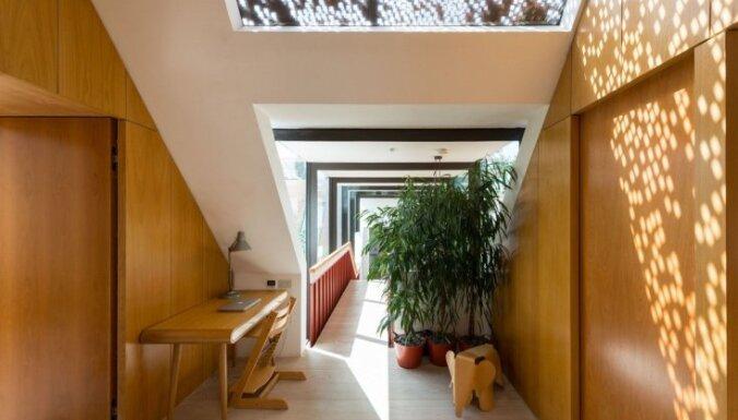 Pamestu garāžu pārvērtības elegantā dzīvojamā mājā