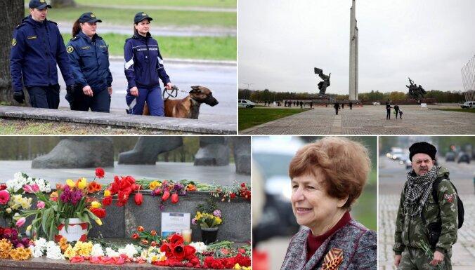 ФОТО: Люди приносят цветы к памятнику Победы, соблюдая ограничения на собрания