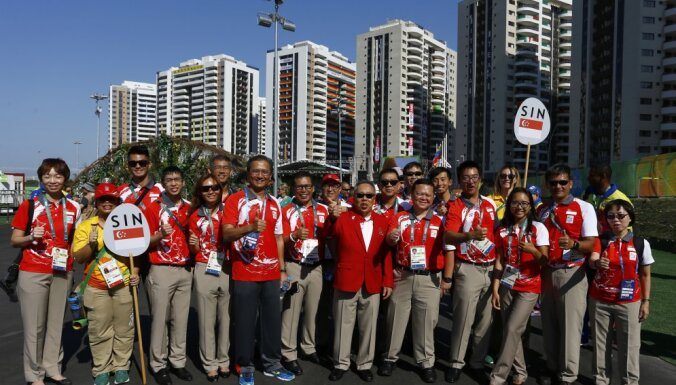 Singapore attend their welcome ceremony at the Olympic Village