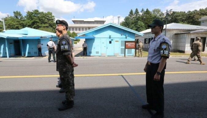 Starp abām Korejām uzsākta robežas atmīnēšana