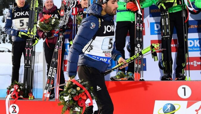 France Martin Fourcade leaves podium