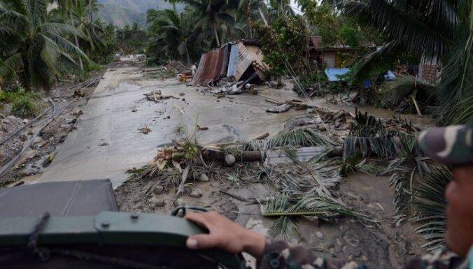 Число жертв тайфуна на Филиппинах превысило 900 человек
