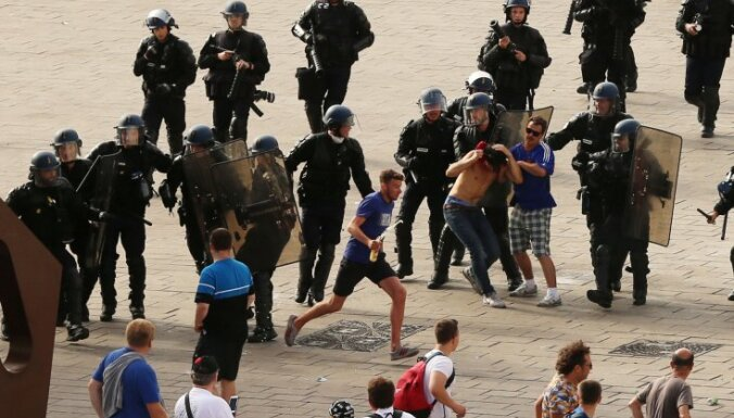French riot police move in to detain Russian soccer fans
