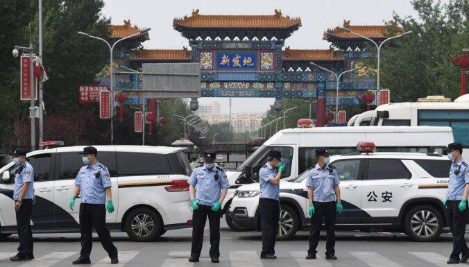 Pekinā jauna Covid-19 uzliesmojuma dēļ ievieš stingrus drošības pasākumus