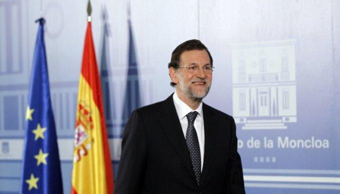 Rahojs atklāj Spānijas jaunās valdības sastāvu; ekonomikas ministrs strādājis 'Lehman Brothers'
