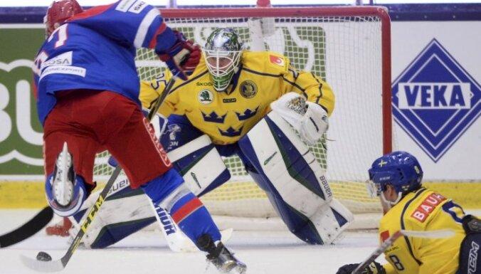 Russia s Vadim Shipachev scores a goal past Sweden s goalie Jacob Markstrom