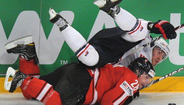 Fotoreportāža: cīņas hokeja laukumā 64 PČ spēlēs