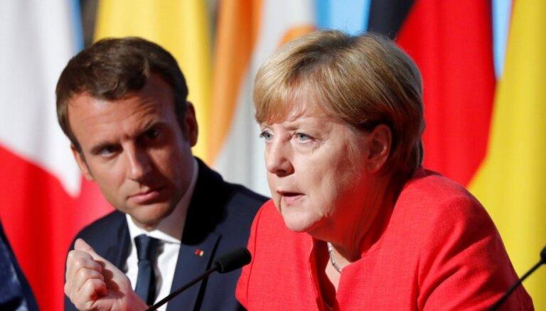 Меркель и Макрон обратились к Путину с призывом по Сирии
